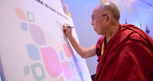 His Holiness signs the pledge to lead a healthy lifestyle
