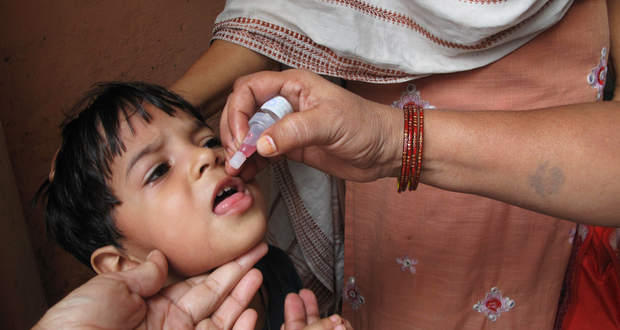 For two polio drops, they must trudge over mountains!