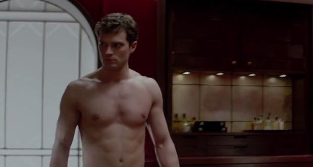 Watch Jamie Dornan scorch the screen with rock hard abs and BDSM in 'Fifty Shades of Grey' trailer