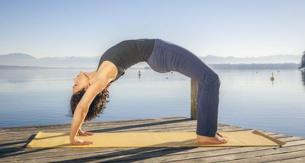 Lose weight from your back and hips with urdhva dhanurasana or the upward bow pose