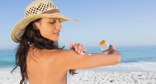 Woman applying suncreen hindi