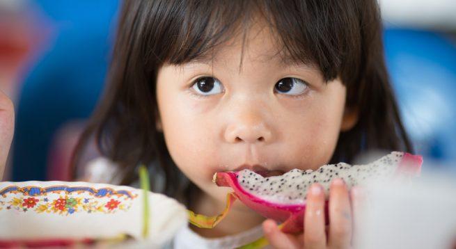 Dragon fruit little girl